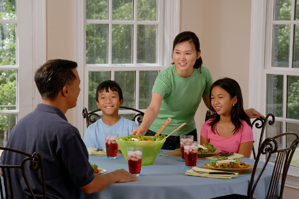 A family of four sitting at the table for dinner