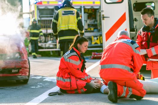 Emergency medical technicians on an accident scene