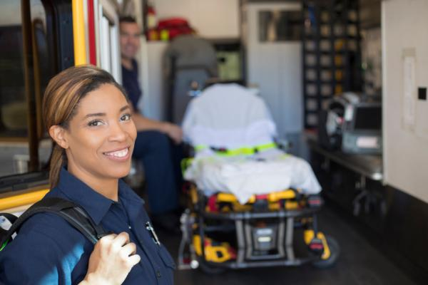 Woman EMT smiling at camera