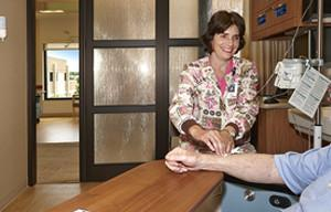 A Nurse is treating a Patient at Cancer Care & Infusion Center - Northfield