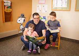 Reading to young children helps develop their brains